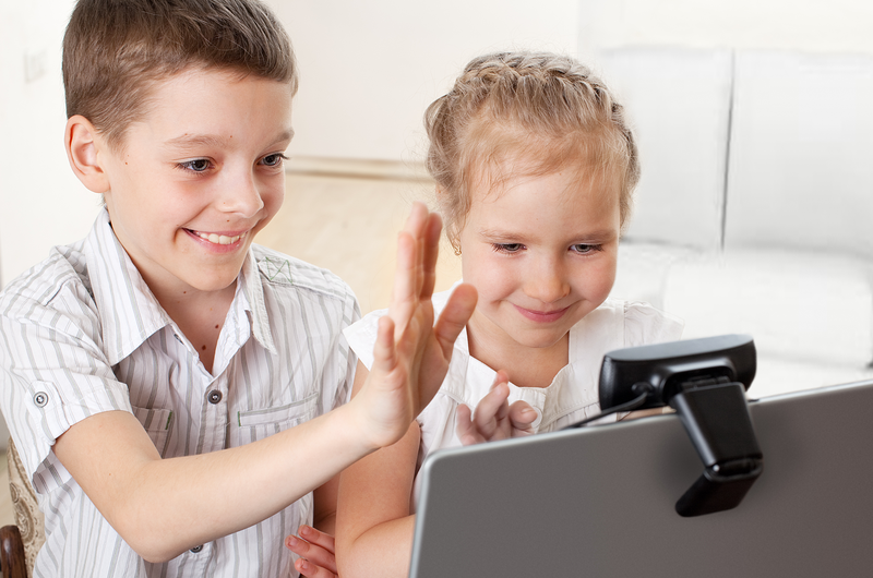 While Schools Are Closed, Try These Fun Activities to Keep the Kids Amused Skype with Grandma Image